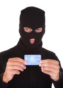 Burglar Holding Credit Card